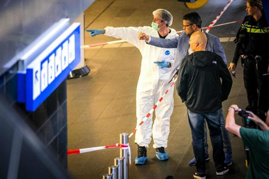Policemen and forensics are at work after a stabbing incident at the central station in Amsterdam, on Aug 31, 2018.