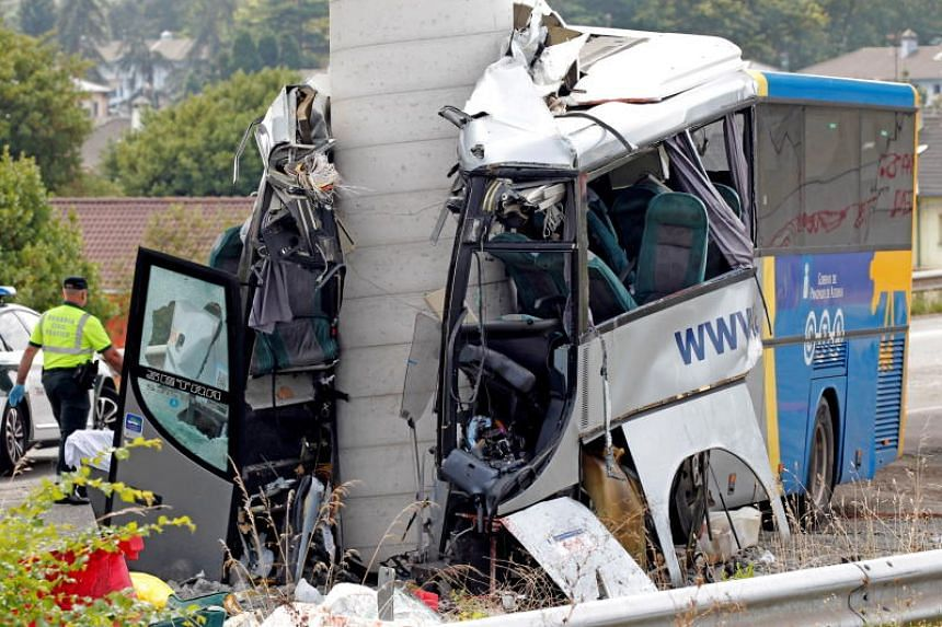 Spanish forensic and rescue services personnel work in the scene where a bus crashed into a highway pillar in Aviles, Asturias, northern Spain, on Sept 3, 2018.