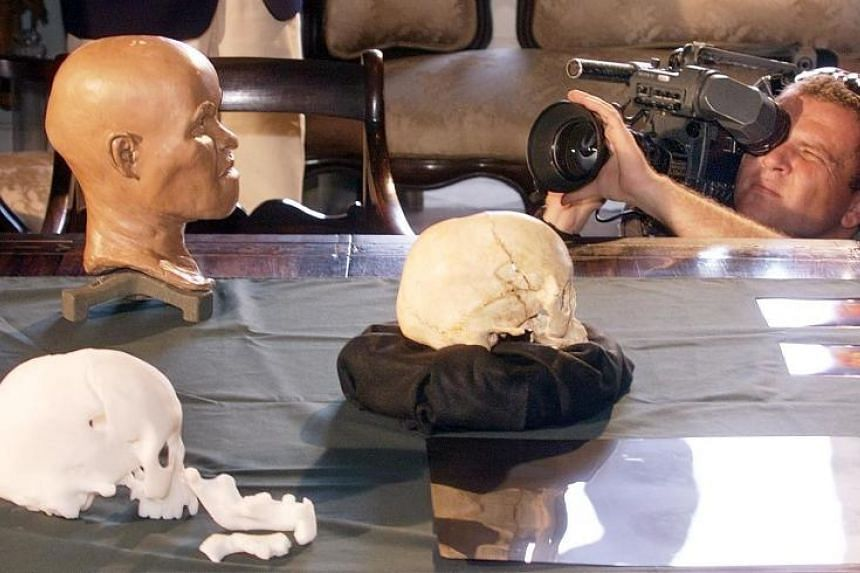 "A cameraman recording the presentation of the reconstruction of the head of ""Luzia"", the first Brazilian woman, at the National Museum of History in Rio de Janeiro, Brazil, on Sept 20, 1999."