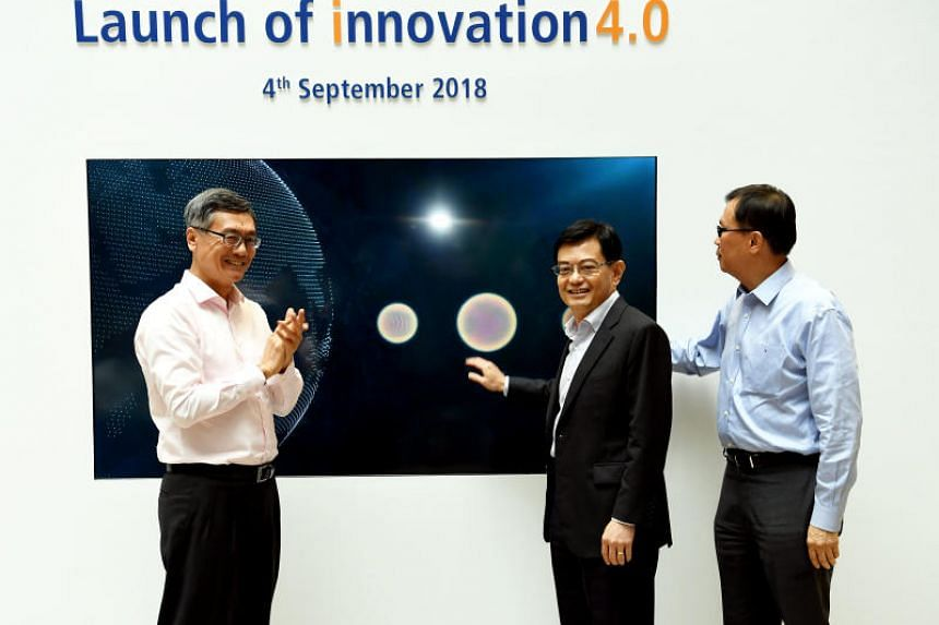From left: NUS president Tan Eng Chye, Finance Minister Heng Swee Keat and NUS senior deputy president and provost Ho Teck Hua at the launch of NUS' innovation4.0 building on Sept 4, 2018.