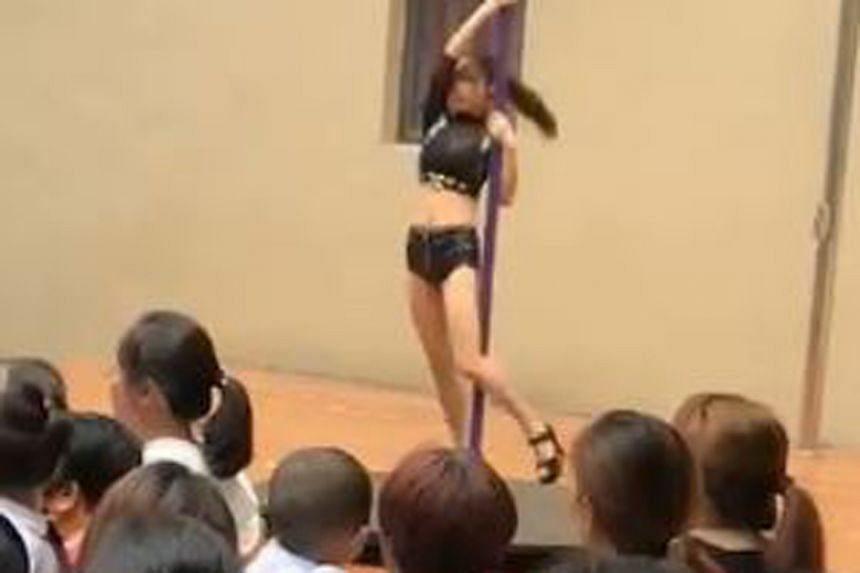 The pole-dancing act at a kindergarten in Shenzhen was part of a ceremony observing the start of China's school year.
