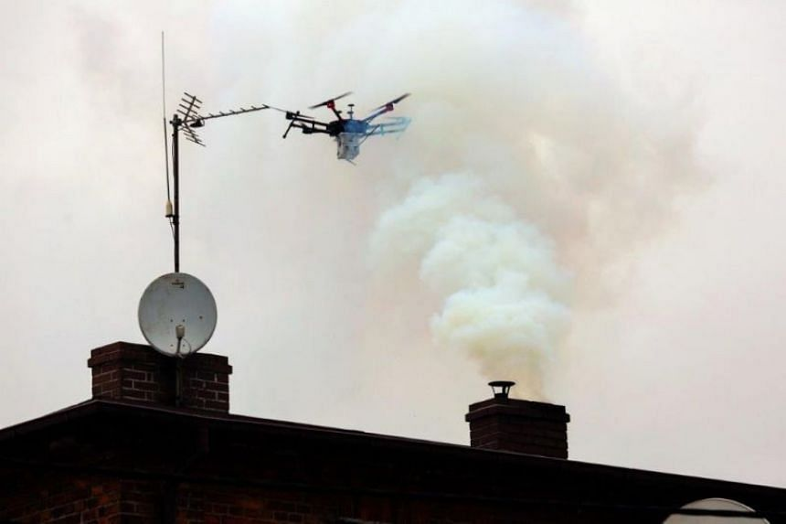 A handout picture released by the Municipal police in the southern Polish city of Katowice shows a drone monitoring smoke coming out of a chimney, on Jan 23, 2018.