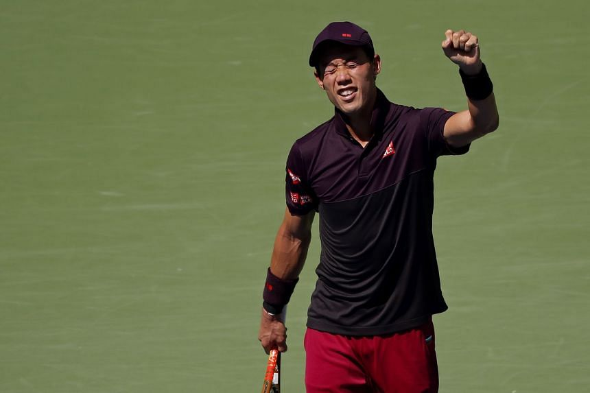 Kei Nishikori of Japan celebrates after match point against Philipp Kohlschreiber of Germany (not pictured) in the fourth round on day eight of the US Open at USTA Billie Jean King National Tennis Center.