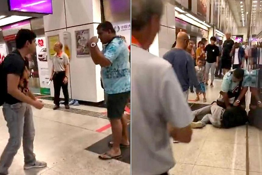 Screengrabs from the video showing the two men in a fighting stance (left) on the North-East Line train platform of Dhoby Ghaut MRT station on Sunday. The man in black charges at the man in blue and is pinned down by him (right). The men were eventua