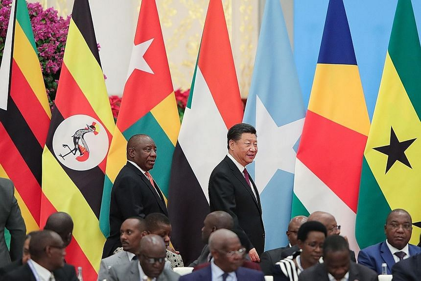 South African President Cyril Ramaphosa and Chinese President Xi Jinping at the Forum on China-Africa Cooperation summit in Beijing yesterday. The summit adopted an action plan, identifying eight major initiatives as the focus of China-Africa coopera