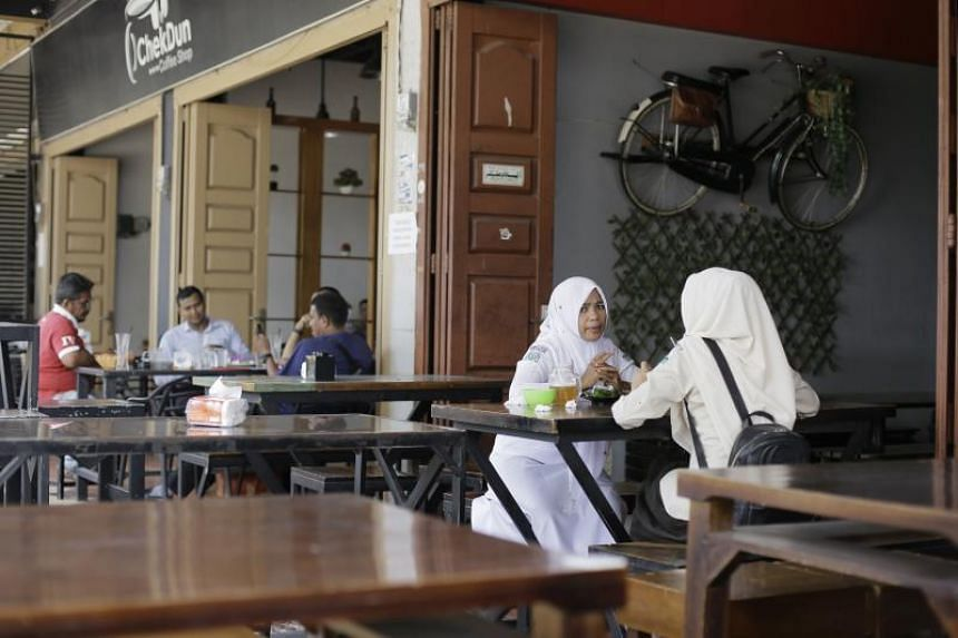 Under the latest Islamic regulation, women in Bireuen district on Sumatra island will not be able to share a table with men at restaurants and coffee shops, unless they are accompanied by their husband or a close male relative.