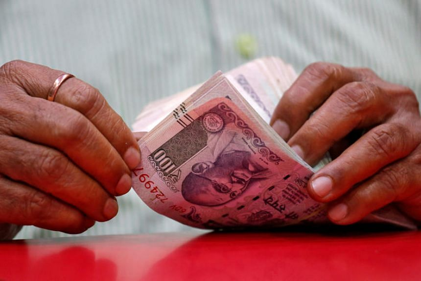 India's rupee fell 0.49 per cent to the US dollar, and The Reserve Bank of India likely sold dollars at 71.80 rupees in the local spot forex market to stem the sharp fall.