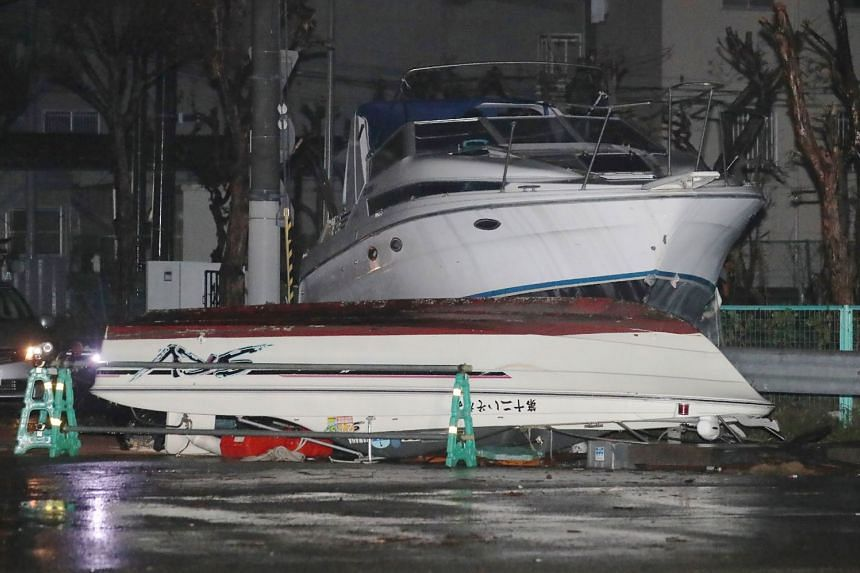Boats lie on a street after being carried by storm surge caused by Typhoon Jebi.