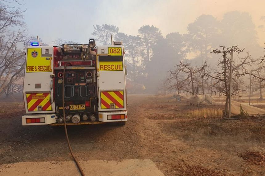 A fire engine is parked near a bushfire in New South Wales, Australia, on Aug 15, 2018.