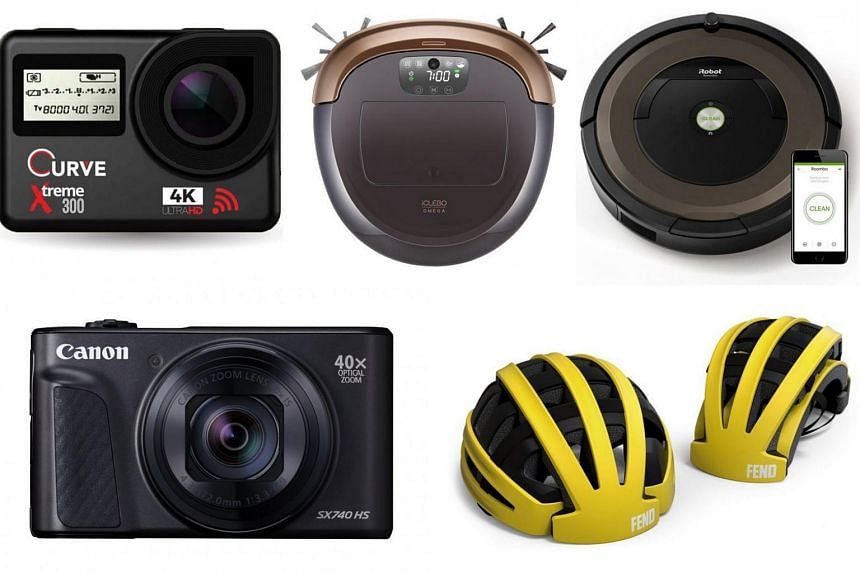 (Clockwise from top left) Curve Xtreme 300 4K Wi-Fi Action Camera, iClebo Omega, iRobot Roomba 890, Fend bicycle helmet, and Canon PowerShot SX740 HS.