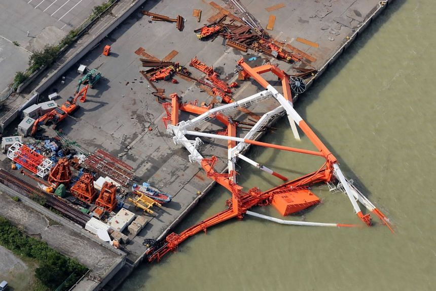 An aerial view from a Jiji Press helicopter shows a crane that toppled due to strong winds in Nishinomiya city, Hyogo prefecture, on Sept 5, 2018, after typhoon Jebi hit the west coast of Japan.