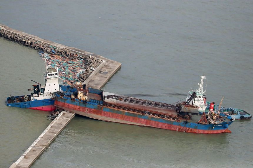An aerial view from a Jiji Press helicopter shows a ship that collided with a breakwater due to strong winds caused by typhoon Jebi in Nishinomiya city, Hyogo prefecture, on Sept 5, 2018.