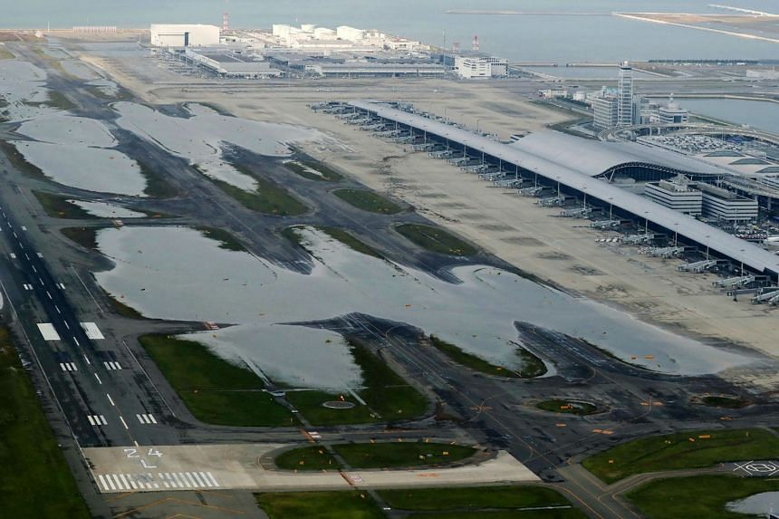 An aerial view from a Jiji Press helicopter shows flooding at the Kansai International Airport in Izumisano city, Osaka prefecture, on Sept 5, 2018, after typhoon Jebi hit the west coast of Japan.