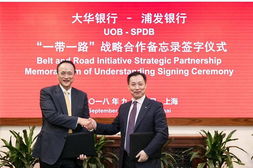 Mr Frederick Chin (left), head of group wholesale banking at UOB, and Mr Wang Xinhao, executive vice-president of SPD Bank, signing an MOU to help more companies tap the BRI for cross-border business opportunities.