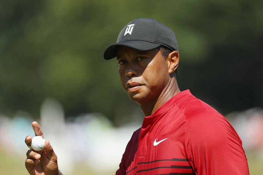Woods acknowledges the crowd during the final round of the Dell Technologies Championship.