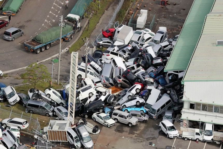 Cars piled up a day after the powerful Typhoon Jebi hit the area in Kobe, western Japan, on Sept 5, 2018.