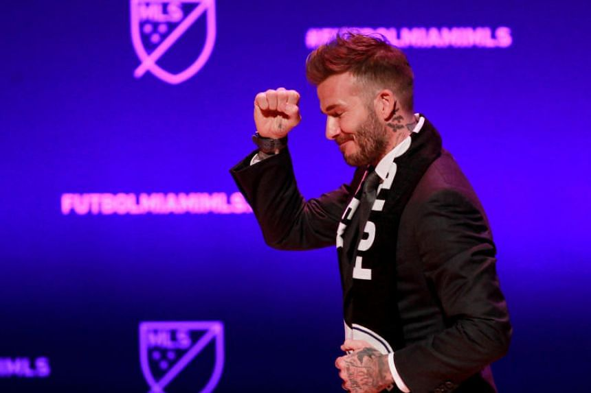 David Beckham, wearing a league scarf, salutes a section of the crowd at the official announcement for Miami's Major League Soccer expansion team in Miami, Florida, on Jan 29, 2018.