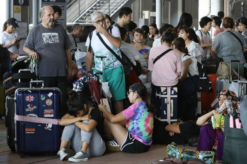 Passengers stranded overnight at the Kansai International Airport in Izumisano city, Osaka prefecture, on Sept 5, 2018.