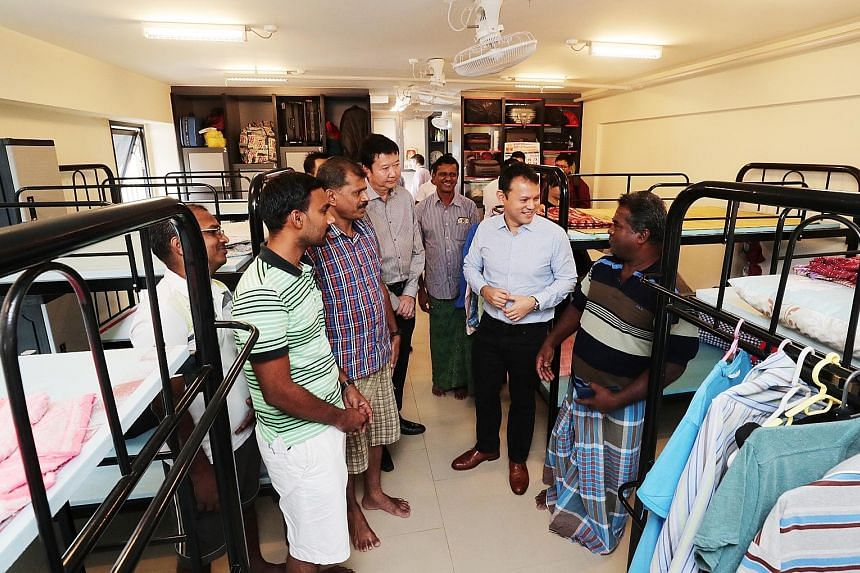 Minister of State for Manpower Zaqy Mohamad talking with workers during a visit to a dorm in Greyform Building. Mr Zaqy said enforcement efforts have been tightened with the use of analytics.
