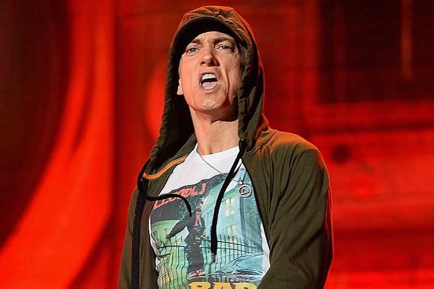 Rapper Eminem takes aim at the music press, United States President Donald Trump and other rappers in his new album.