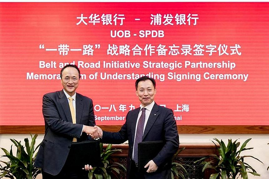Mr Frederick Chin (left), head of group wholesale banking at UOB, and Mr Wang Xinhao, executive vice-president of Shanghai Pudong Development Bank, at yesterday's ceremony. The banks aim to help more companies tap opportunities in the BRI.