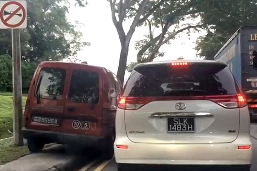 The red van is seen in a video uploaded online moving slowly on the pavement. Driver Jason Zy Cheong said he was in a hurry to pick up his child from the childcare centre and apologised for his behaviour.