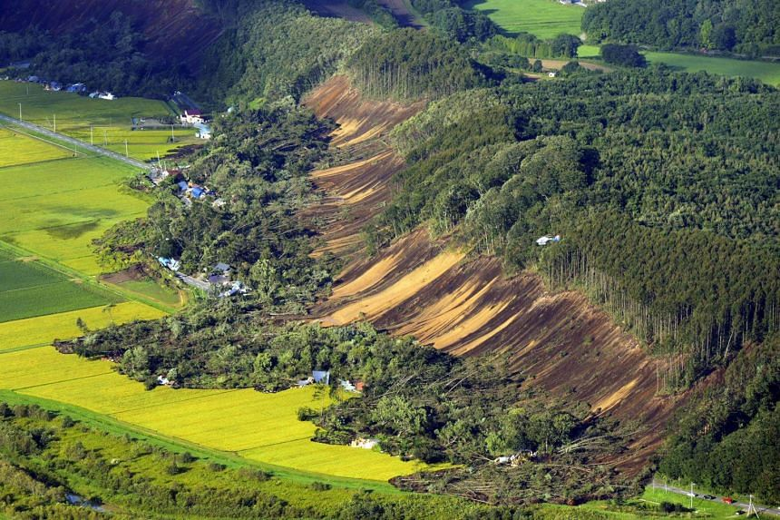 An aerial photo shows the aftermath of a large landslide that occurred after an earthquake hit Hokkaido, on Sept 6, 2018.
