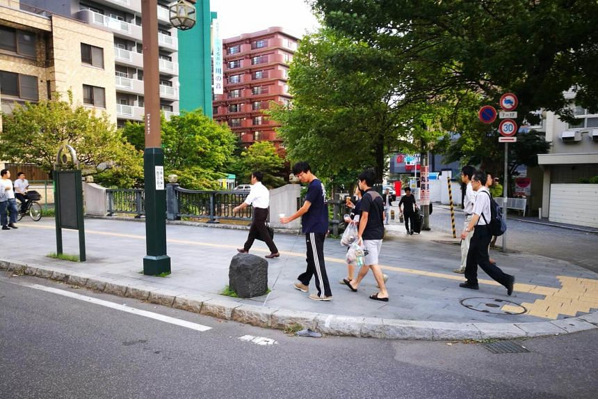 Locals in Sapporo, capital of Hokkaido, heading to work after a earthquake hit the northern Japanese island, on Sept 6, 2018.