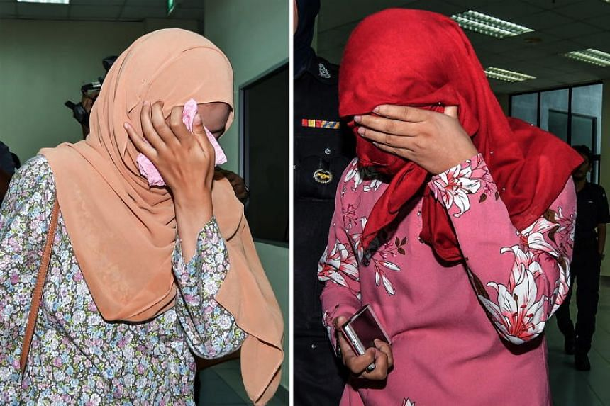 Two women, each caned six times after they pleaded guilty to homosexual activity at the Sharia High Court in Terengganu, Malaysia, on Sept 3, 2018.