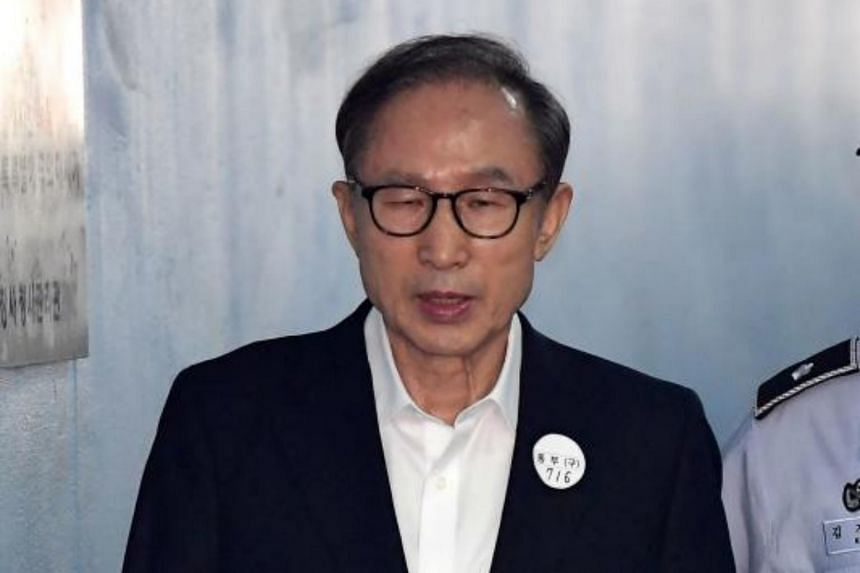 Former South Korean president Lee Myung-bak arrives at a court in Seoul to attend his trial on Sept 6, 2018.