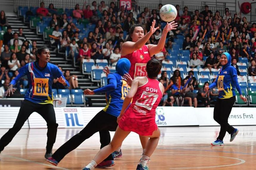 Singapore's Lee Pei Shan in action during the M1 Asian Netball Championship match against Malaysia on Sept 6, 2018.