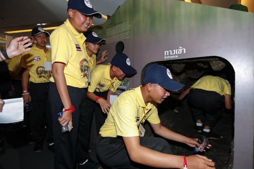 Members of the Wild Boar youth soccer team examine a mock Tham Luang cave at the exhibition titled Tham Luang Incredible Mission: The Global Agenda in Bangkok on Sept 6, 2018.
