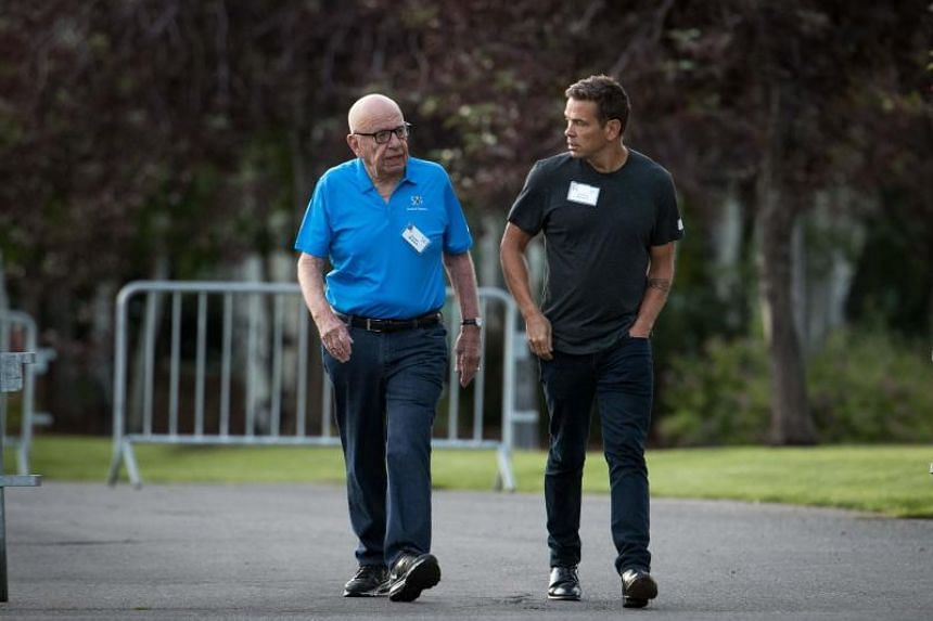 Rupert Murdoch (left), executive chairman of News Corp and chairman of Fox News, and Lachlan Murdoch, co-chairman of 21st Century Fox, walk together on July 13, 2017.