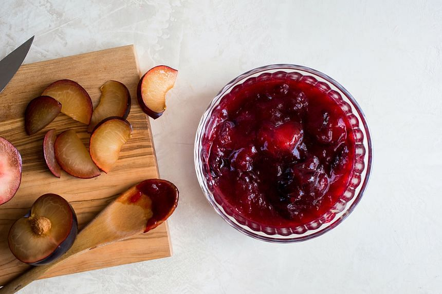Sliced, simmered and puréed plums prepared for a shortbread plum tart.