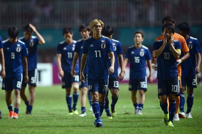 Japan's national football players leave the field after being defeated by South Korea in the final men's competition of the Asian Games in Bogor, Indonesia, on Sept 1, 2018.