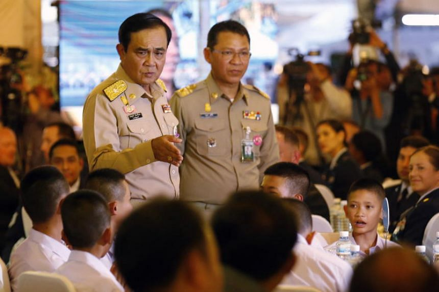 Thai Prime Minister Prayut Chan-o-cha talks to the members of the young Thai football team who were rescued from Tham Luang during a thank-you dinner in Bangkok on Sept 6, 2018.
