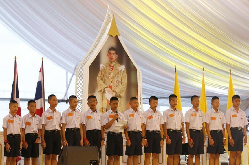 Members of the young Thai football team who were rescued from Tham Luang give speeches during a thank-you dinner presided by Prime Minister Prayut Chan-o-cha in Bangkok on Sept 6, 2018.