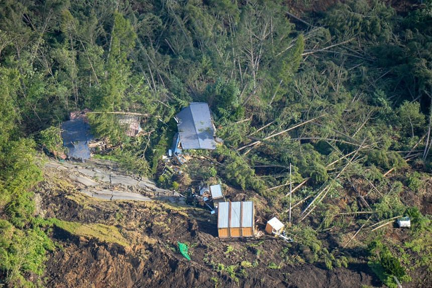 An aerial view of houses damaged by a landslide in Atsuma town, on Sept 6, 2018, after an earthquake hit the northern Japanese island of Hokkaido.