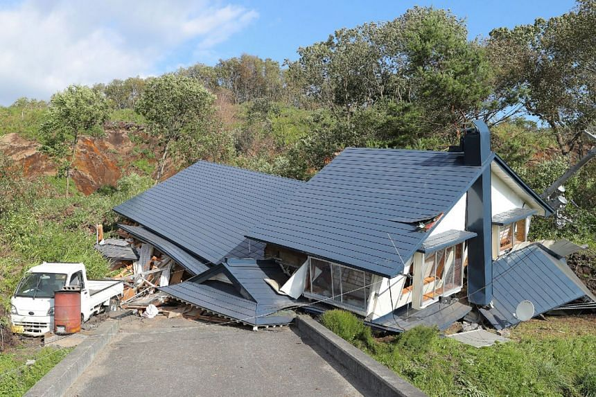 A house damaged by a landslide caused by an earthquake in Atsuma town in Hokkaido prefecture, on Sept 6, 2018.