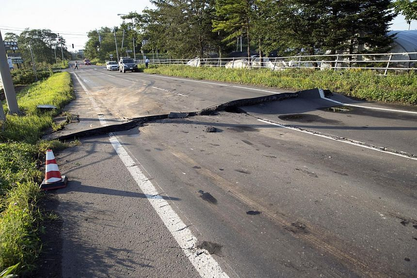 A damaged road is seen in Abira town after a strong earthquake hit Hokkaido, northern Japan, on Sept 6, 2018.
