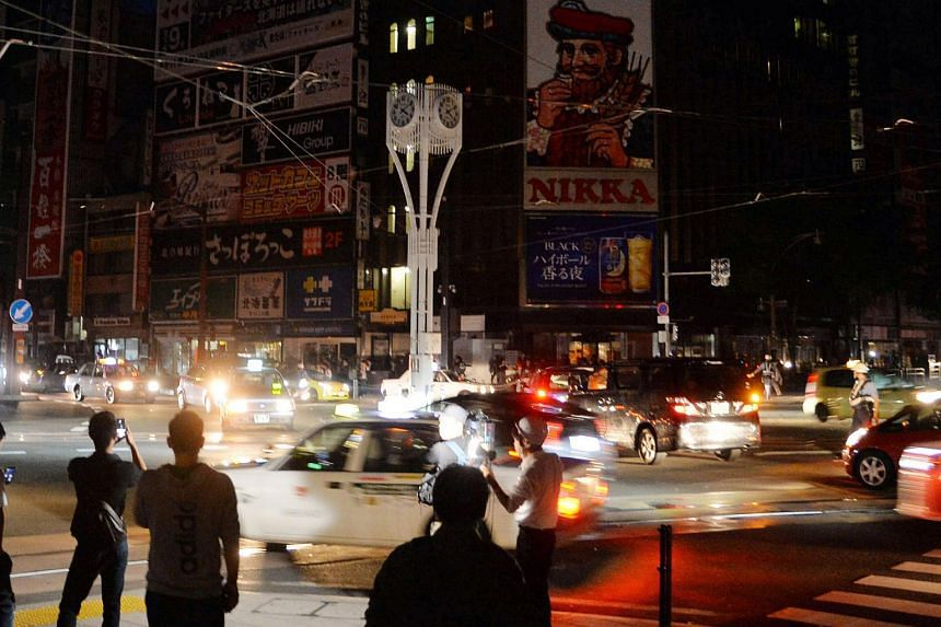 Traffic at an intersection during a blackout after a strong earthquake hit Sapporo, Japan, on Sept 6, 2018.