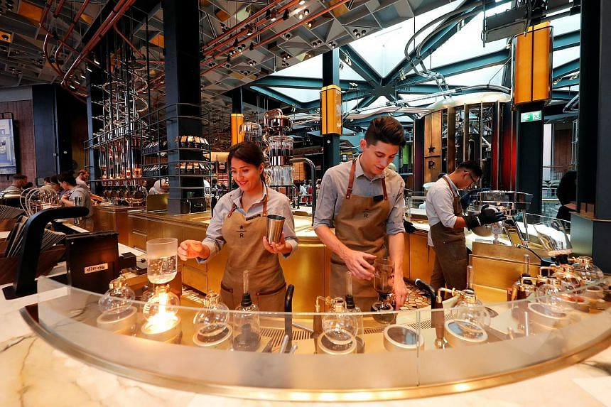 Employees prepare coffee inside the new Starbucks Reserve Roastery flagship in downtown Milan, Italy, on Sept 4, 2018.