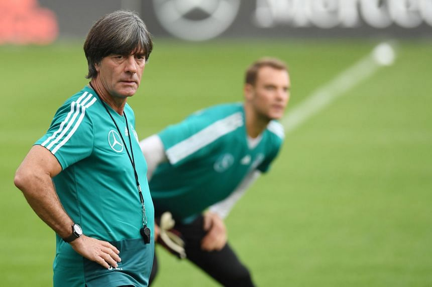 Joachim Low oversees a training session ahead of Germany's first Uefa Nations League game with world champions France, as skipper Manuel Neuer warms up in the background. The 2014 World Cup-winning coach acknowledges they have to show a different att