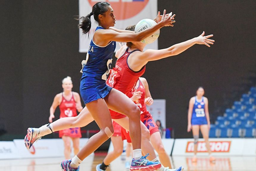 Singapore's Nurul Baizura keeping the ball beyond the reach of her Hong Kong opponent during their second-round game at the OCBC Arena. Singapore lost 50-49 to an older, more experienced Hong Kong side.