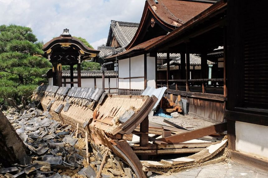 A wall at the Nishi Honganji temple in Kyoto collapsed during the storm. Winds in many places gusted to the highest ever recorded in Japan.