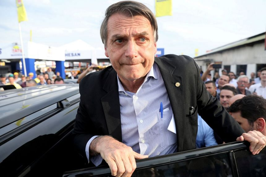 Jair Bolsonaro leaves after visiting an agribusiness fair in Brazil on Aug 29, 2018.