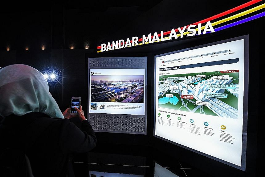 An exhibition on the high-speed rail project in Kuala Lumpur last year. The HSR terminus in Singapore would be located in Jurong East. Property analysts and businesses do not believe the postponement of the project will have a significant impact on t