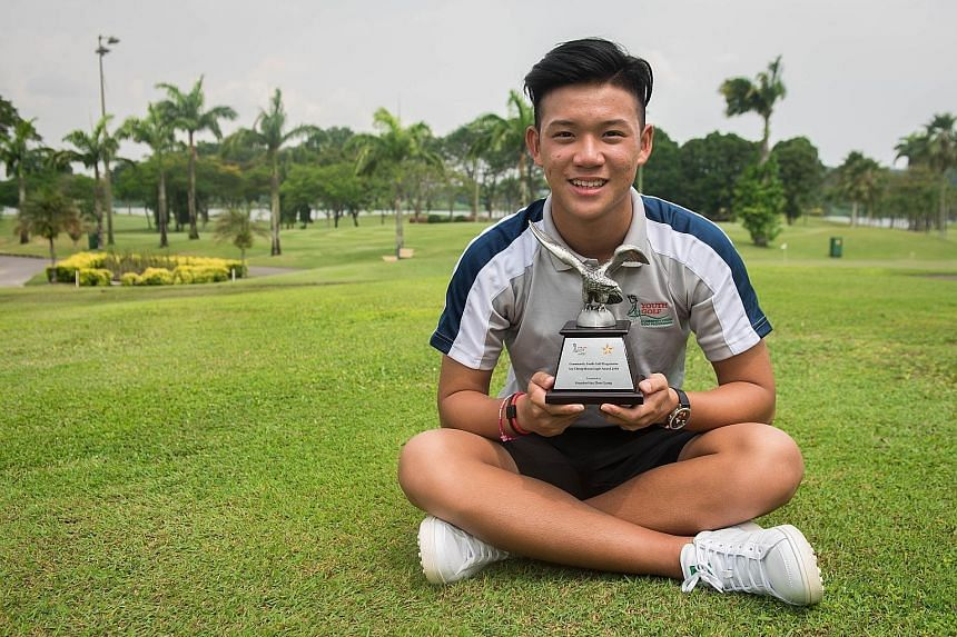 Brandon Han at Orchid Country Club yesterday with the Tay Cheng Khoon Eagle Award he received for being the best performer in the annual Community Youth Golf Programme. The 16-year-old Schools National B Division winner is in the national development