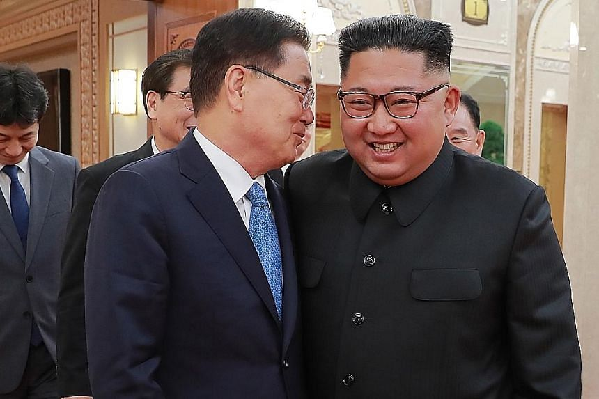 South Korean chief envoy Chung Eui-yong speaking to North Korean leader Kim Jong Un during their talks in Pyongyang on Wednesday.