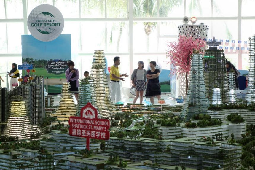 Visitors to Country Gardens' Forest City showroom in Johor Bahru in Malaysia on Aug 28, 2018.